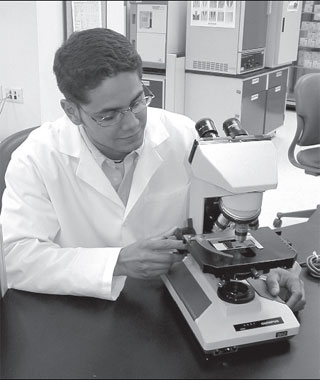 When adjusting the microscope, the technologist observes the objective carefully to prevent breaking the slideand damaging the objective lens of the microscope.